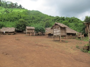 Hmong tribe, northern Laos (note the gathering rain clouds).