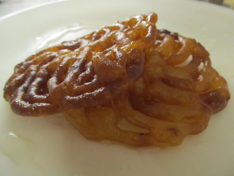 Jalebi is basically deep-fried syrup. And damn, it's good.